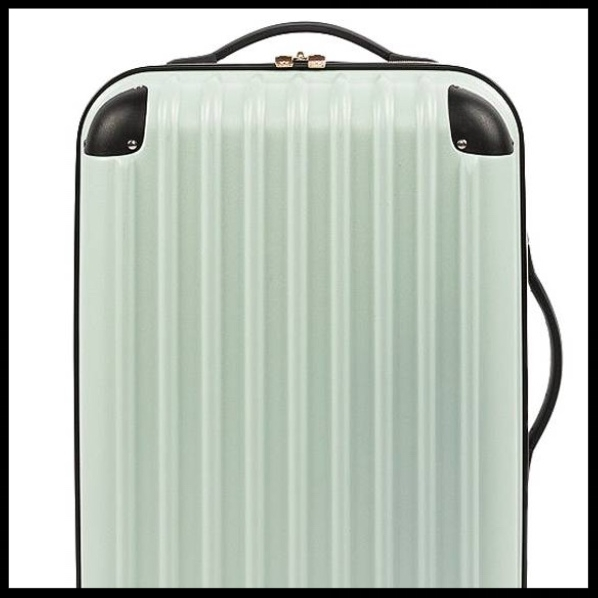 Wit & Delight Hardside Spinner - $79.99 - This mint spinner suitcase is ideal for the lady in your life who loves travel. This durable, hardside spinner by Wit & Delight is the perfect carryon size. Great gift!