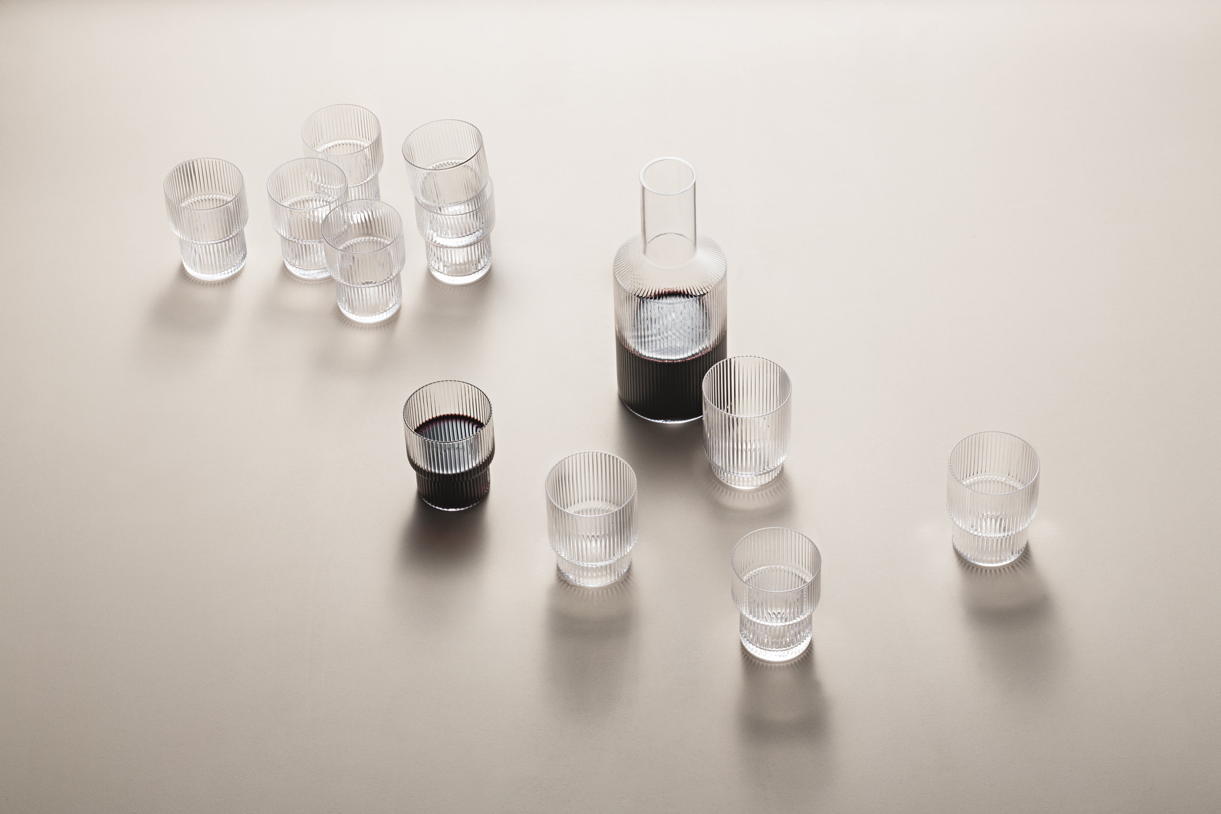 Ripple Glasses and Carafe. Mouth-blown into the mould. Set of 4 glasses with a stackable design.