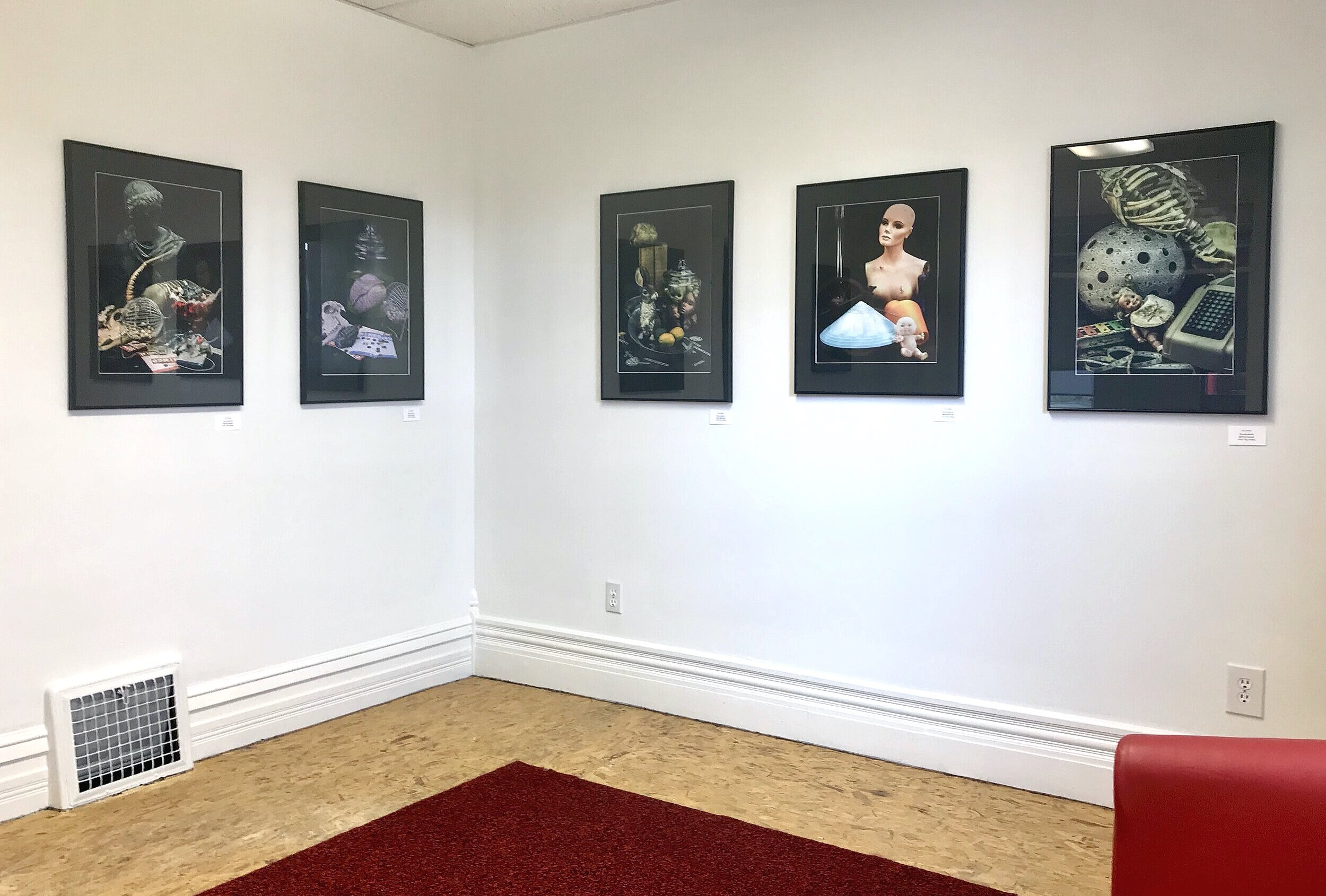 "Joe Donna's solo exhibition, ""Toys n the Attic'"" featuring large-scale color photographs."