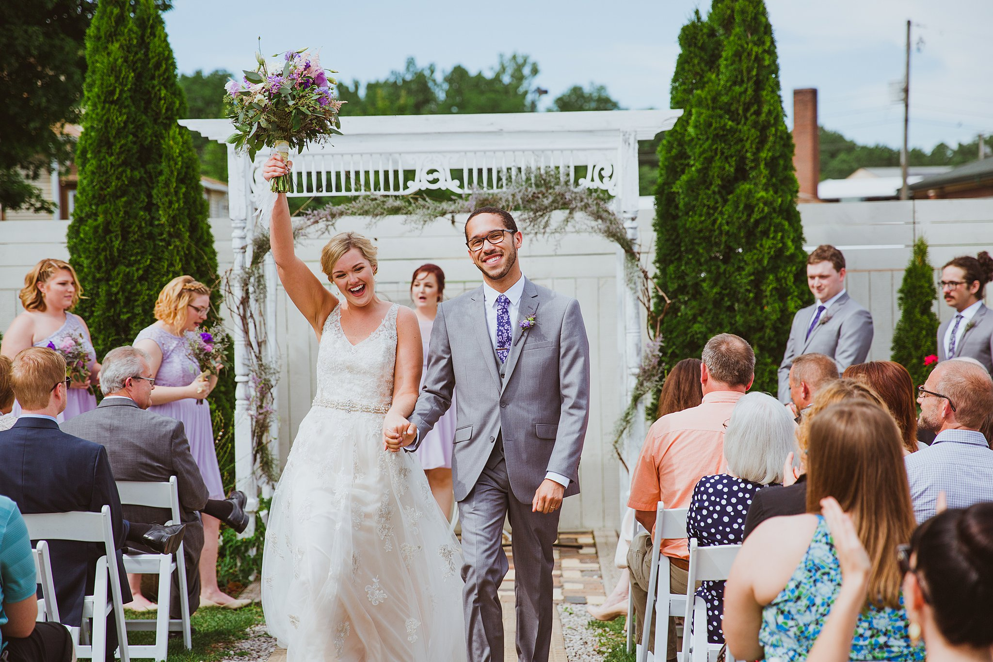wedding bride and groom recessional fist pump
