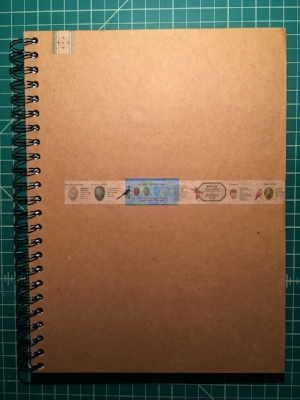 figure 2:  a repurposed sketchbook (old label is under the blue)