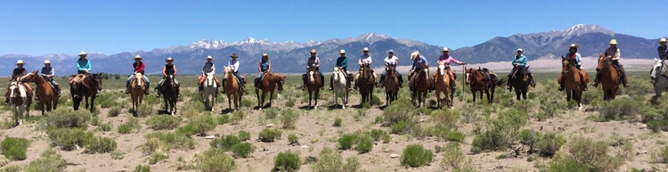 women of zapata ranch riding.jpg