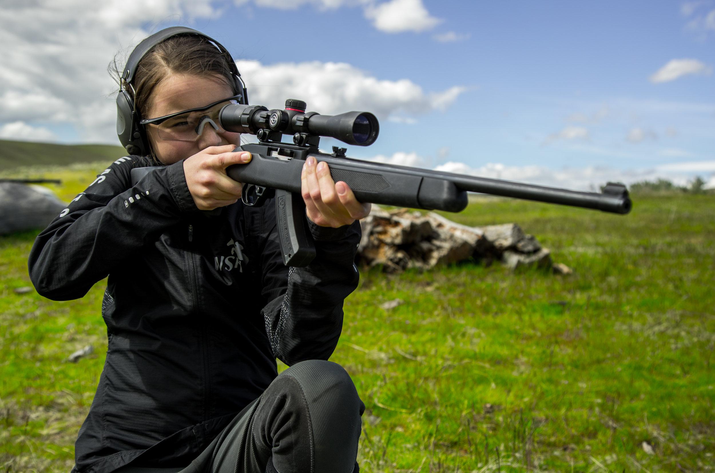 Brinley Kneeling with Rifle.jpg