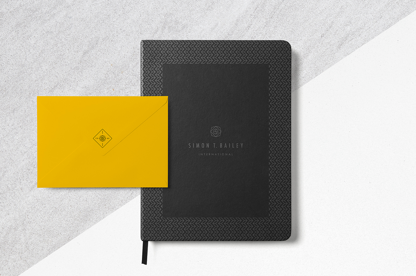 Black journal stationary with envelope on grey (from brand board)