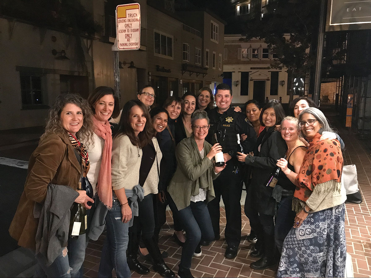 Rings with wine and a local police officer
