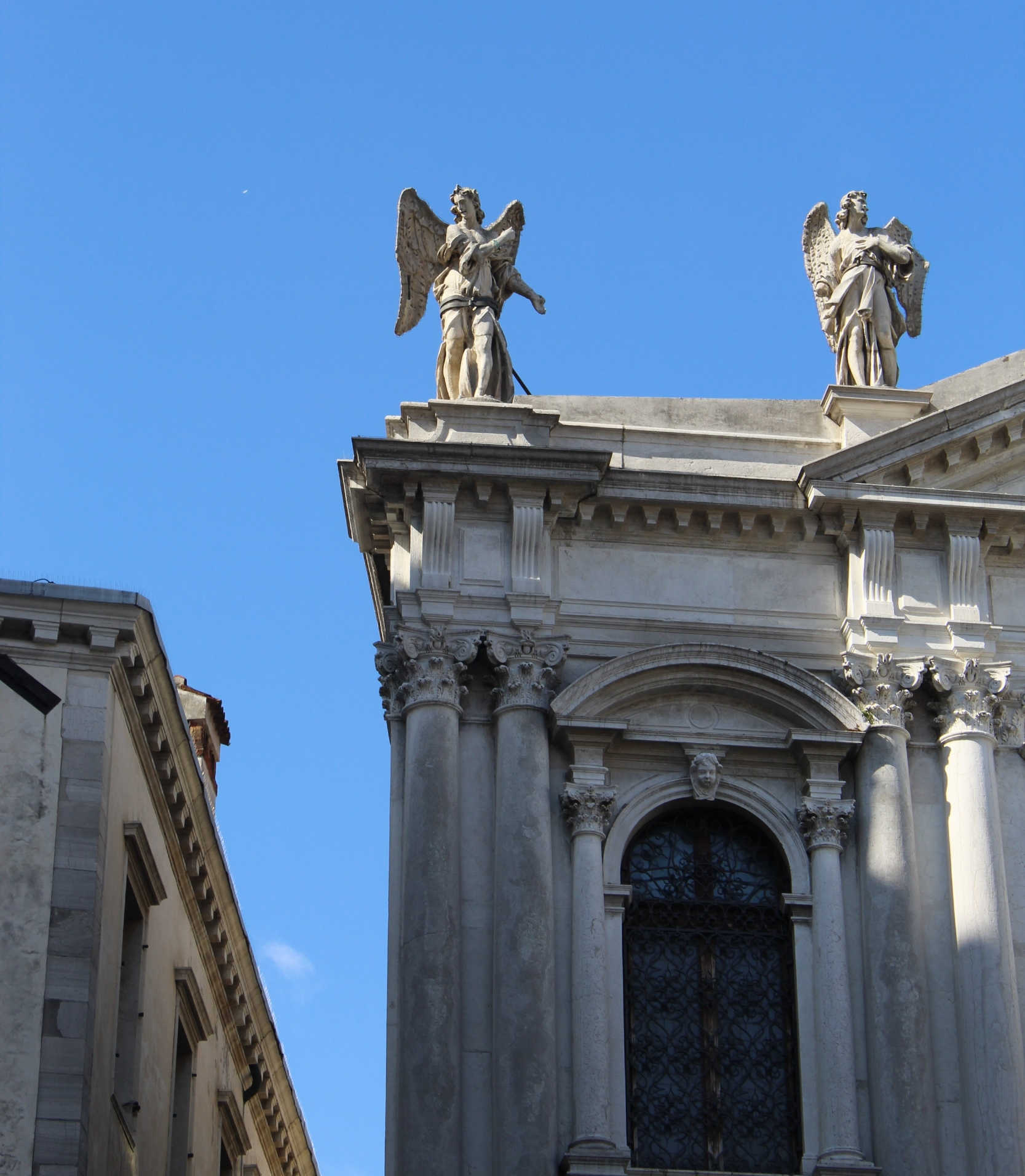 """Stone angels looking down."" - This was the view from our Airbnb in Venice."