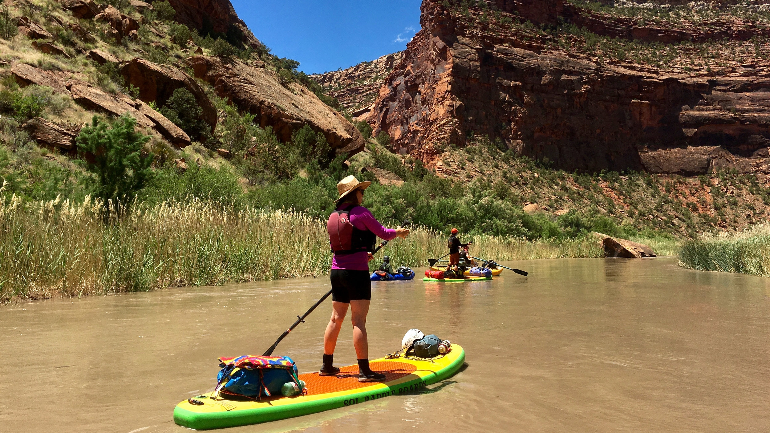 Self support stand up paddle board river trip on the Lower Dolores River in Southwest Colorado
