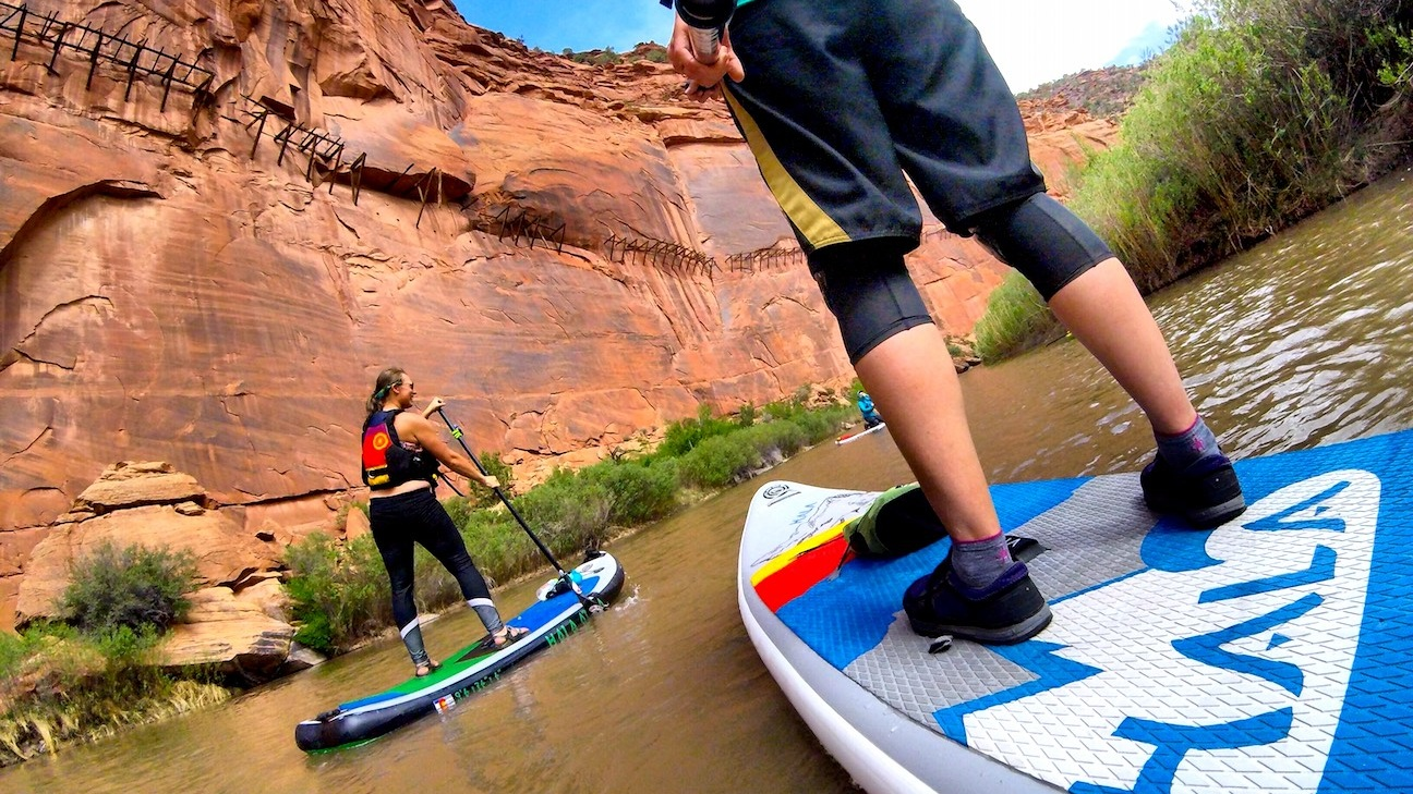 Stand up paddle boarding the under the Hanging Flume on the Lower Dolores River