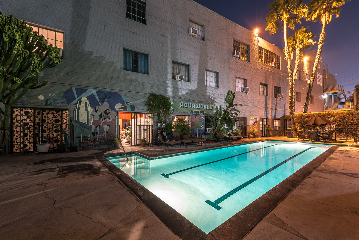 Night view of pool at Long Beach Avenue building