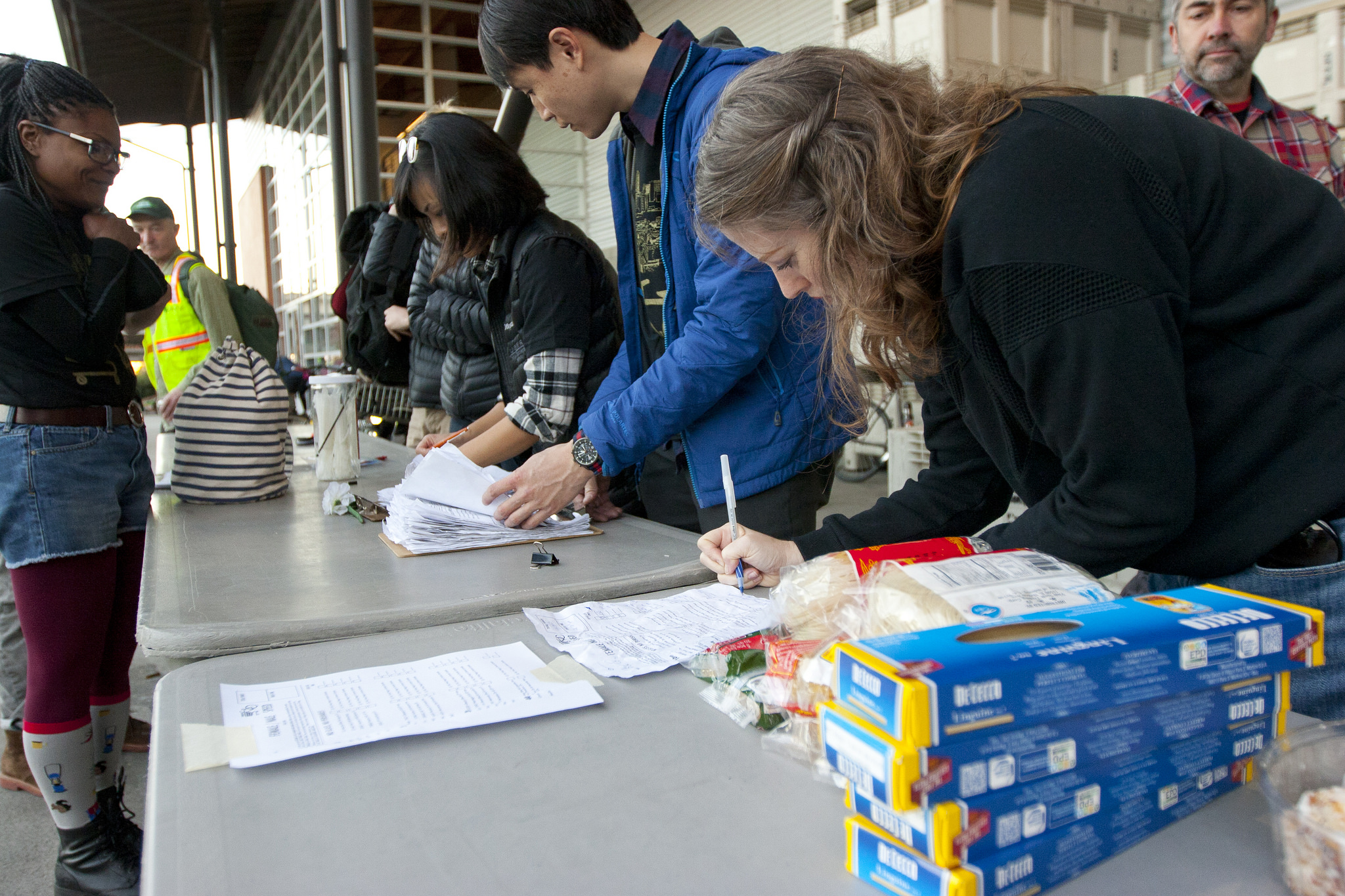 Final speed category manifests being tallied and sorted. Photo by Jonathan Koshi