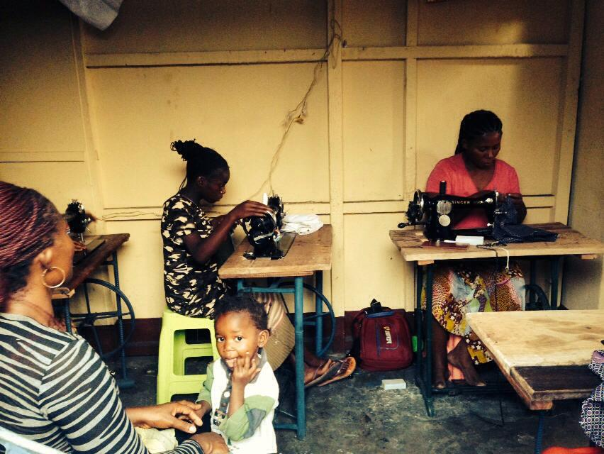 Students learning how to sew.