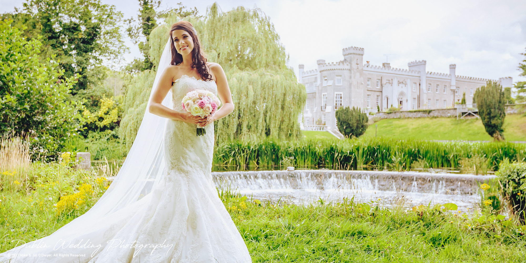 Castle Bellingham Wedding with Bride by the lake