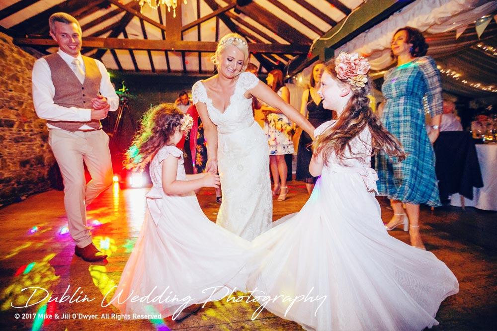 Trudder Lodge Wedding Photographers Bride & Groom and Flowergirls Dancing