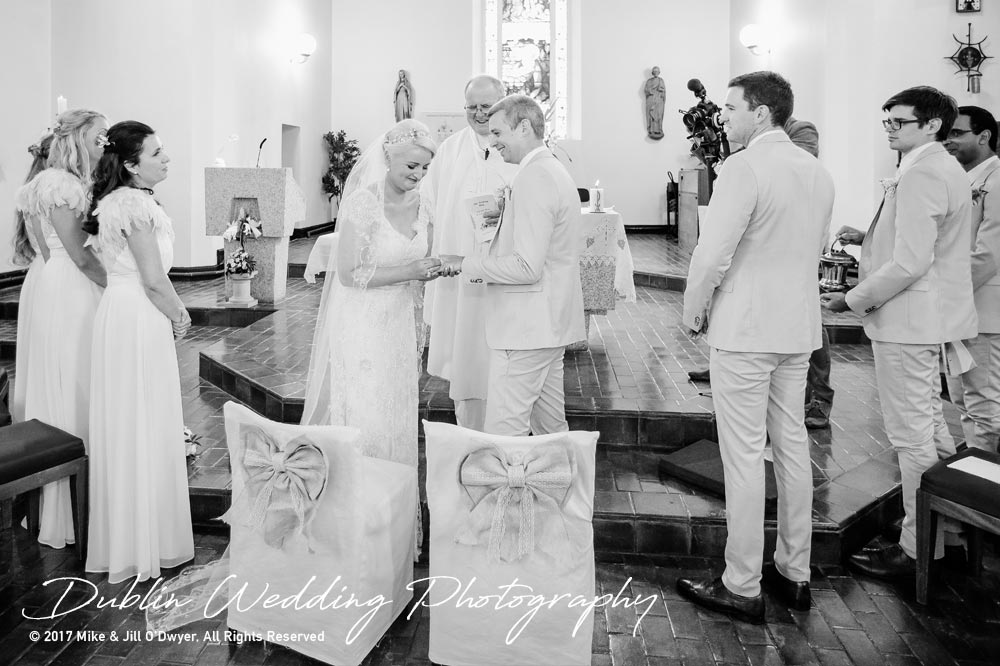 Carlow Wedding Photographers Putting On The Rings in the Church