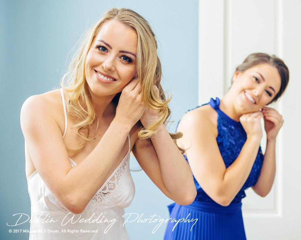 Wedding Photographers Dublin Castle Leslie Monaghan Bride & Bridesmaids Putting on Earrings
