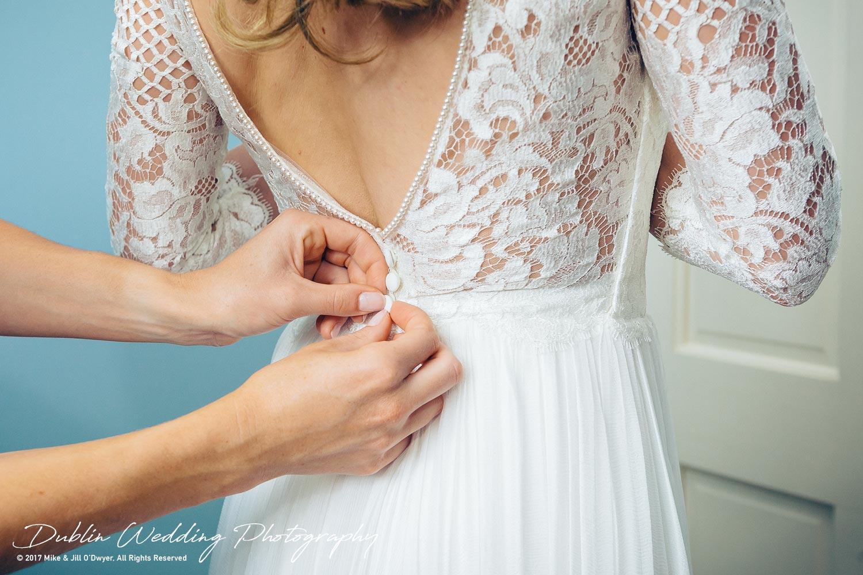 Wedding Photographers Dublin Castle Leslie Monaghan Bride's Dress being Buttoned