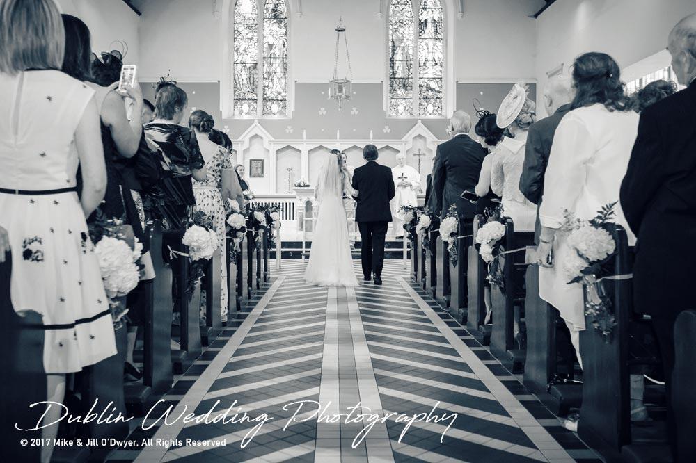 Wedding Photographer Dublin Father & Bride near top of the Aisle