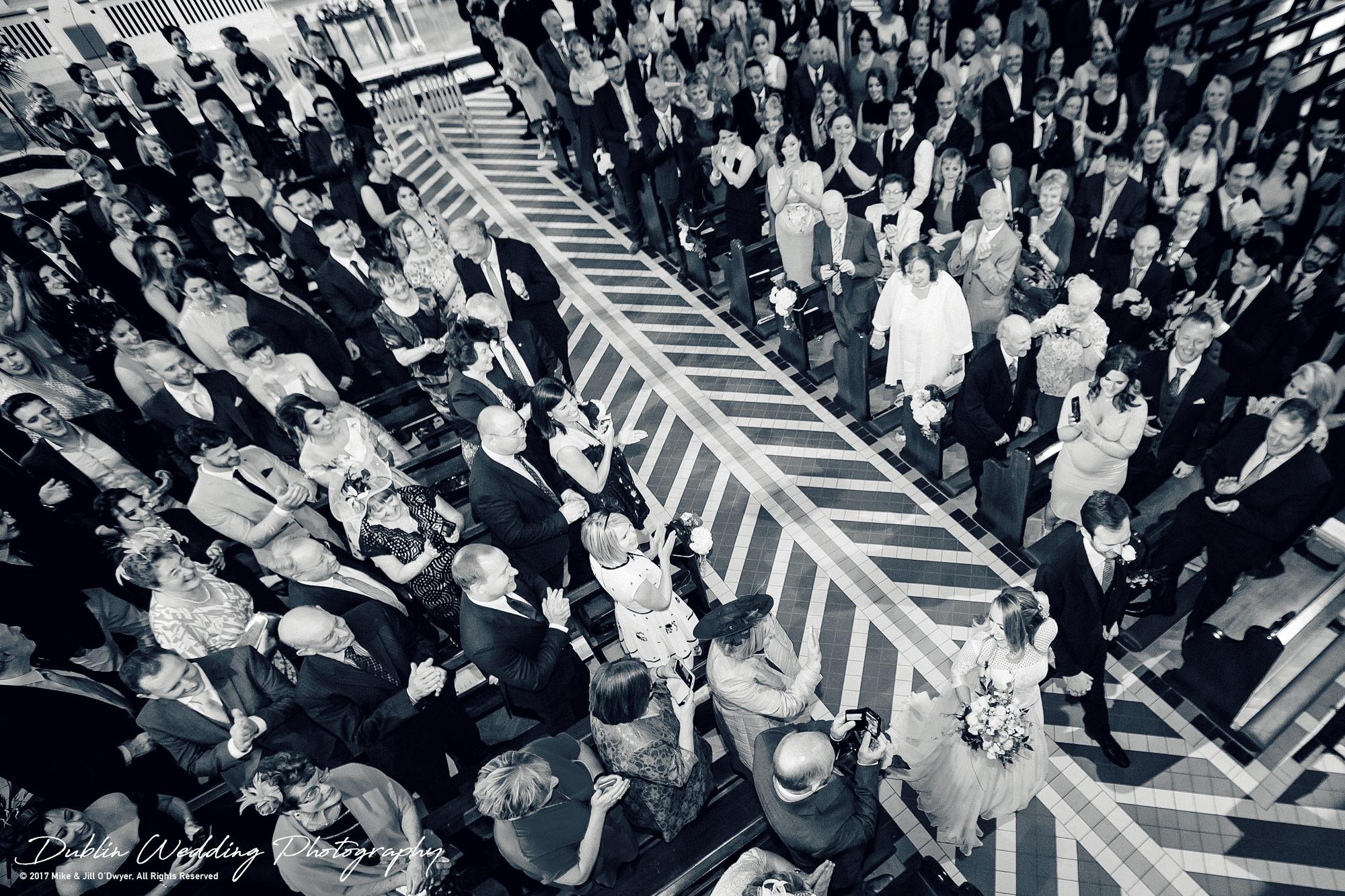 Wedding Photographer Dublin Bride & Groom walking down the aisle