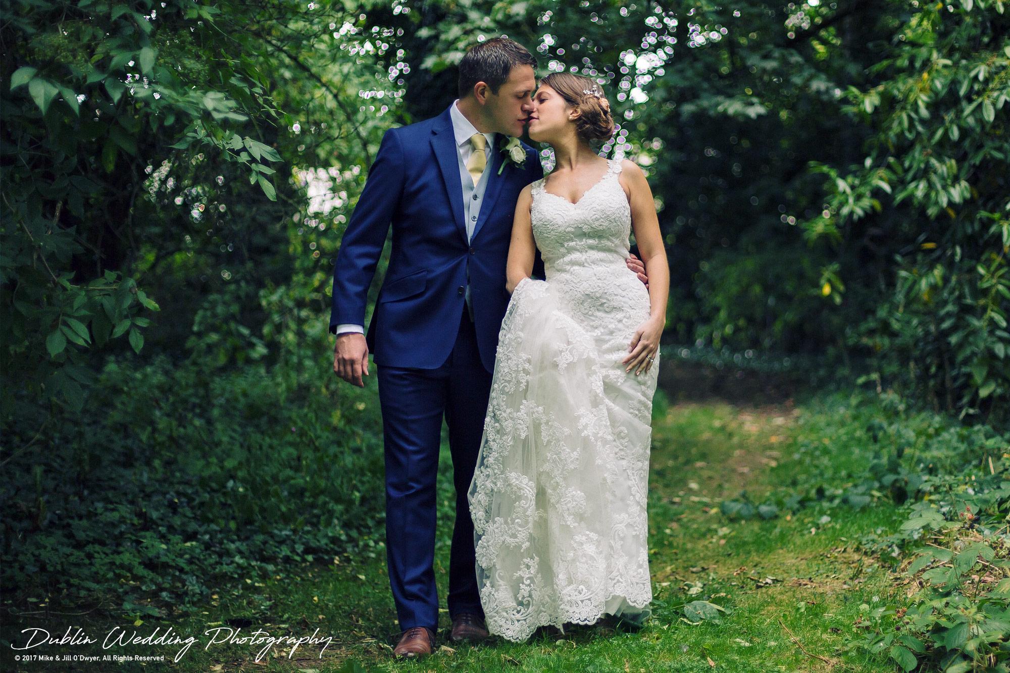 Wedding Photographer Killashee House Hotel Kildare Bride & Groom Kissing in the Woods
