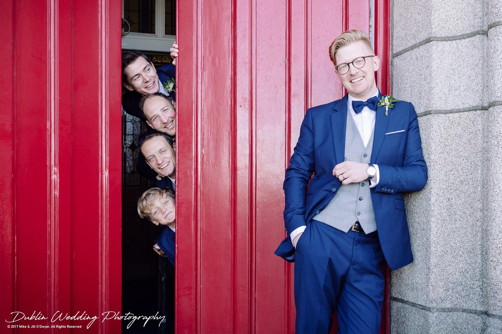 Tinakilly House Wedding Photographer: Groom and Groomsmen at Church Door