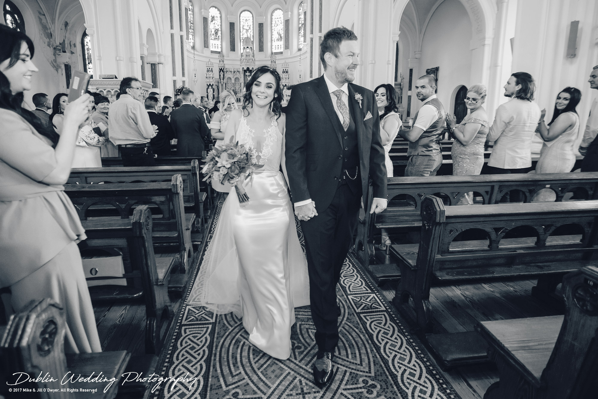 Moyvalley, Balyna House, Wedding Photographer, Kildare, Dublin, Groom walking Bride out of the Church Aisle