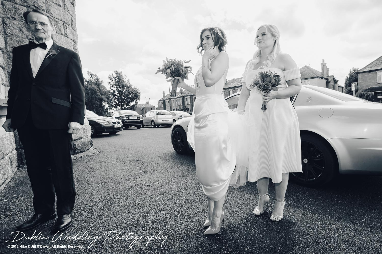 Moyvalley, Balyna House, Wedding Photographer, Kildare, Dublin, Bride & Bridesmaid outside Church