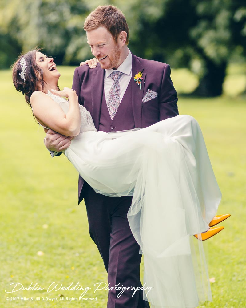 Moyvalley, Balyna House, Wedding Photographer, Kildare, Dublin, Laughing Groom carrying his laughing Bride
