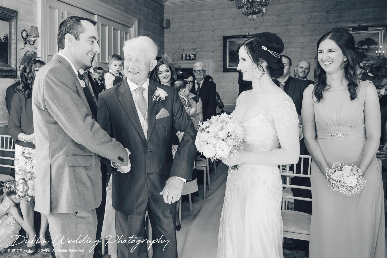 Bellingham Castle, Wedding Photographer, Louth, Dublin, Bride & Father shaking hands with Groom