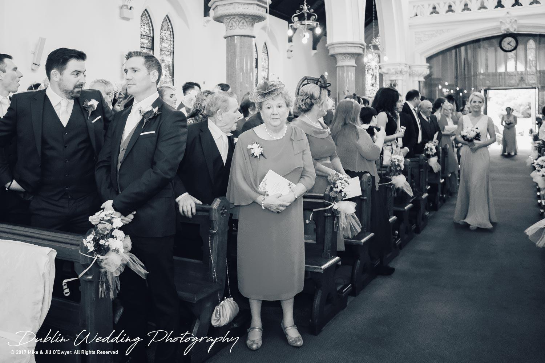 K Club, Kildare, Wedding Photographer, Dublin, Groom waiting in Church as Bridesmaids walk in