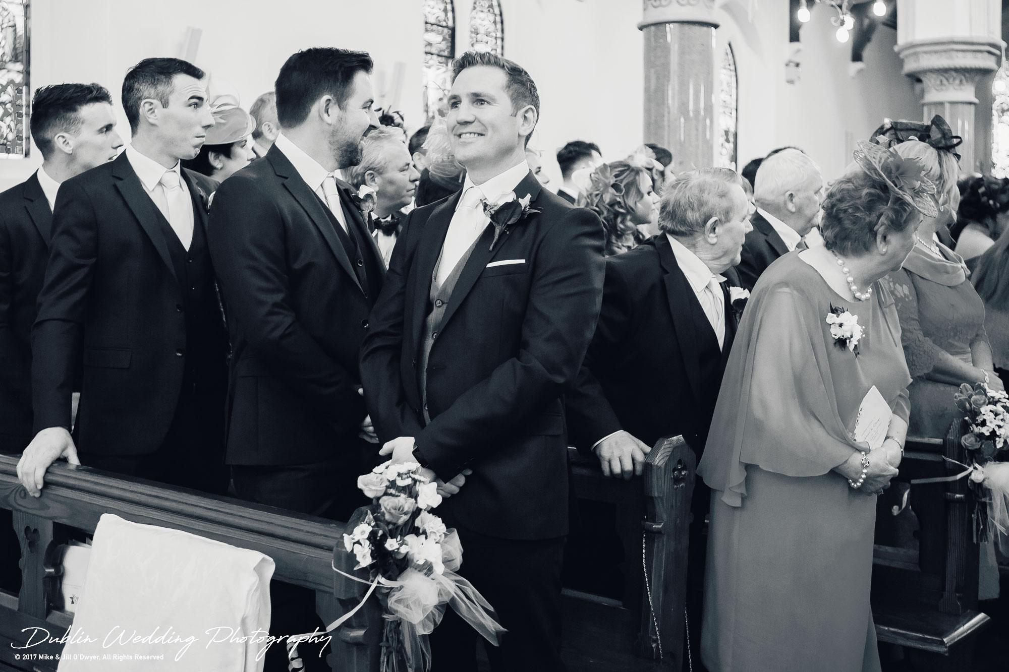 K Club, Kildare, Wedding Photographer, Dublin, Groom happily waiting as Bride walks into Church