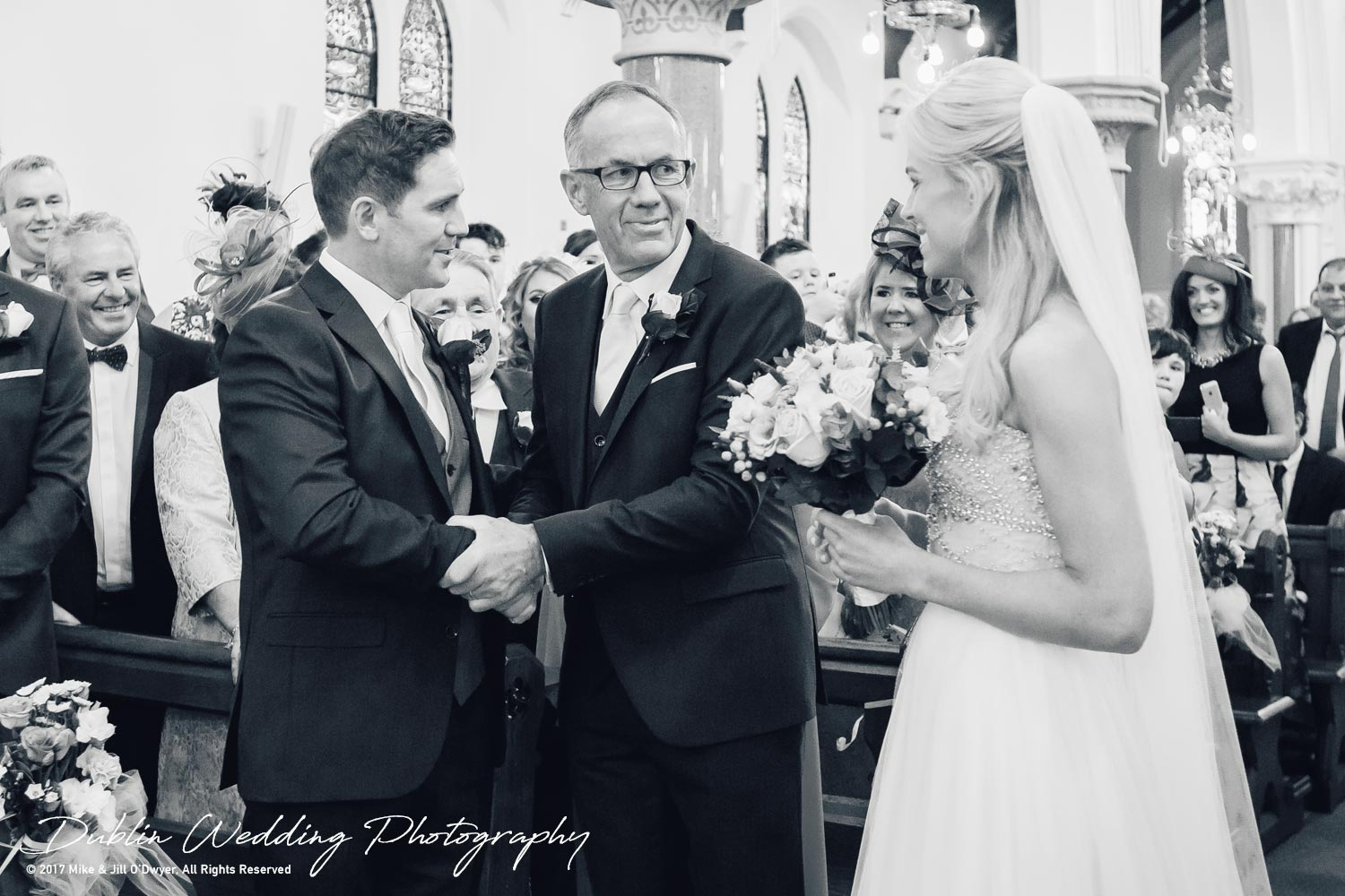 K Club, Kildare, Wedding Photographer, Dublin, Father of the bride and Groom shake hands while the Bride watches