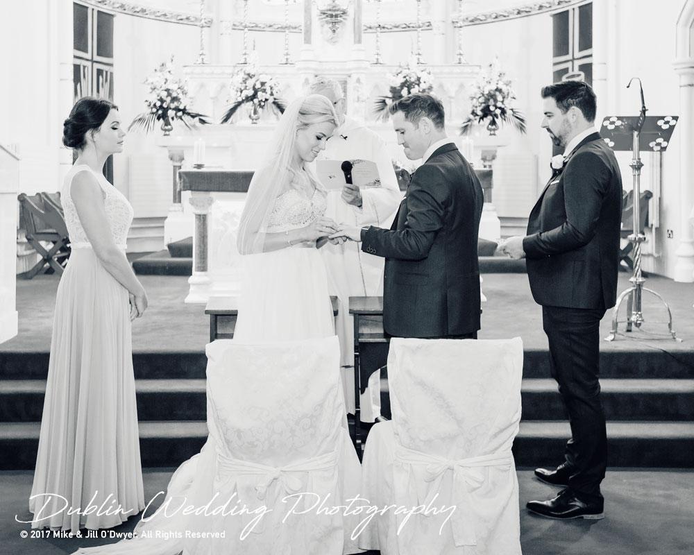 K Club, Kildare, Wedding Photographer, Dublin, Bride puts a ring on Groom's Finger