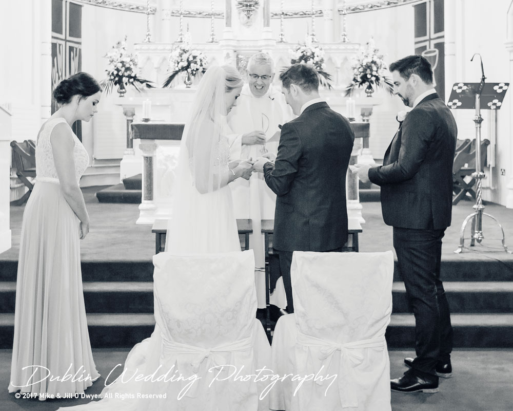 K Club, Kildare, Wedding Photographer, Dublin, Groom puts a ring on the Bride's finger