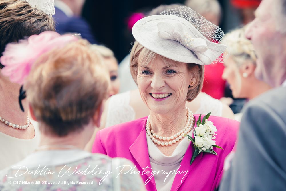 K Club, Kildare, Wedding Photographer, Dublin, Mother of the Bride chatting with guests outside church