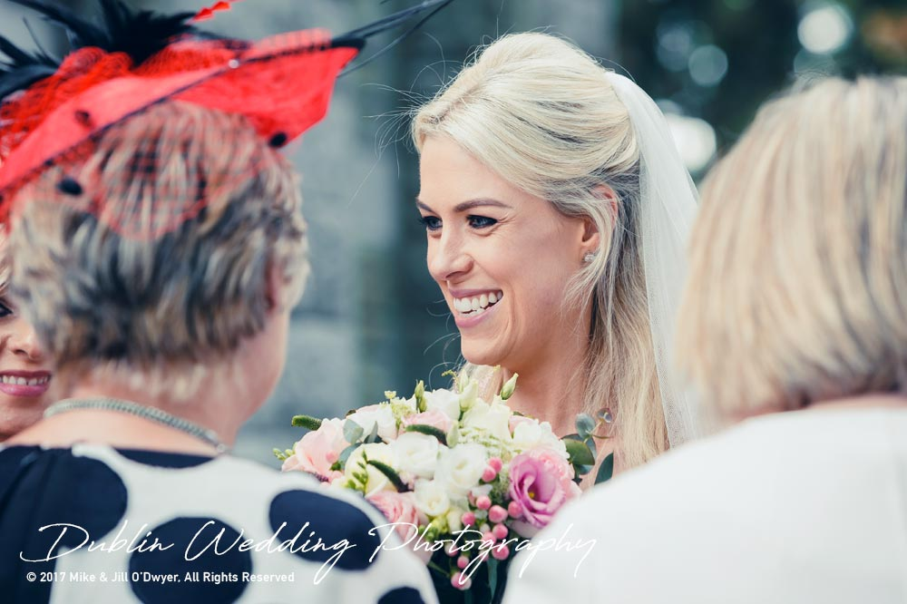 K Club, Kildare, Wedding Photographer, Dublin, Bride chatting to guests outside church