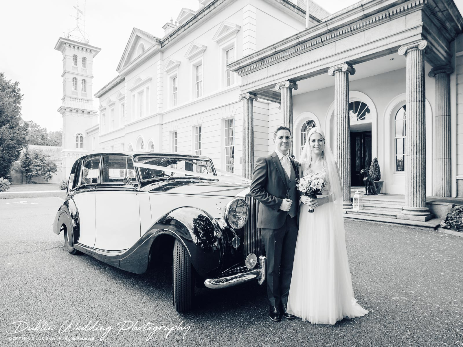 K Club, Kildare, Wedding Photographer, Dublin, Bride and Groom arrive outside the K Club and pose by the car