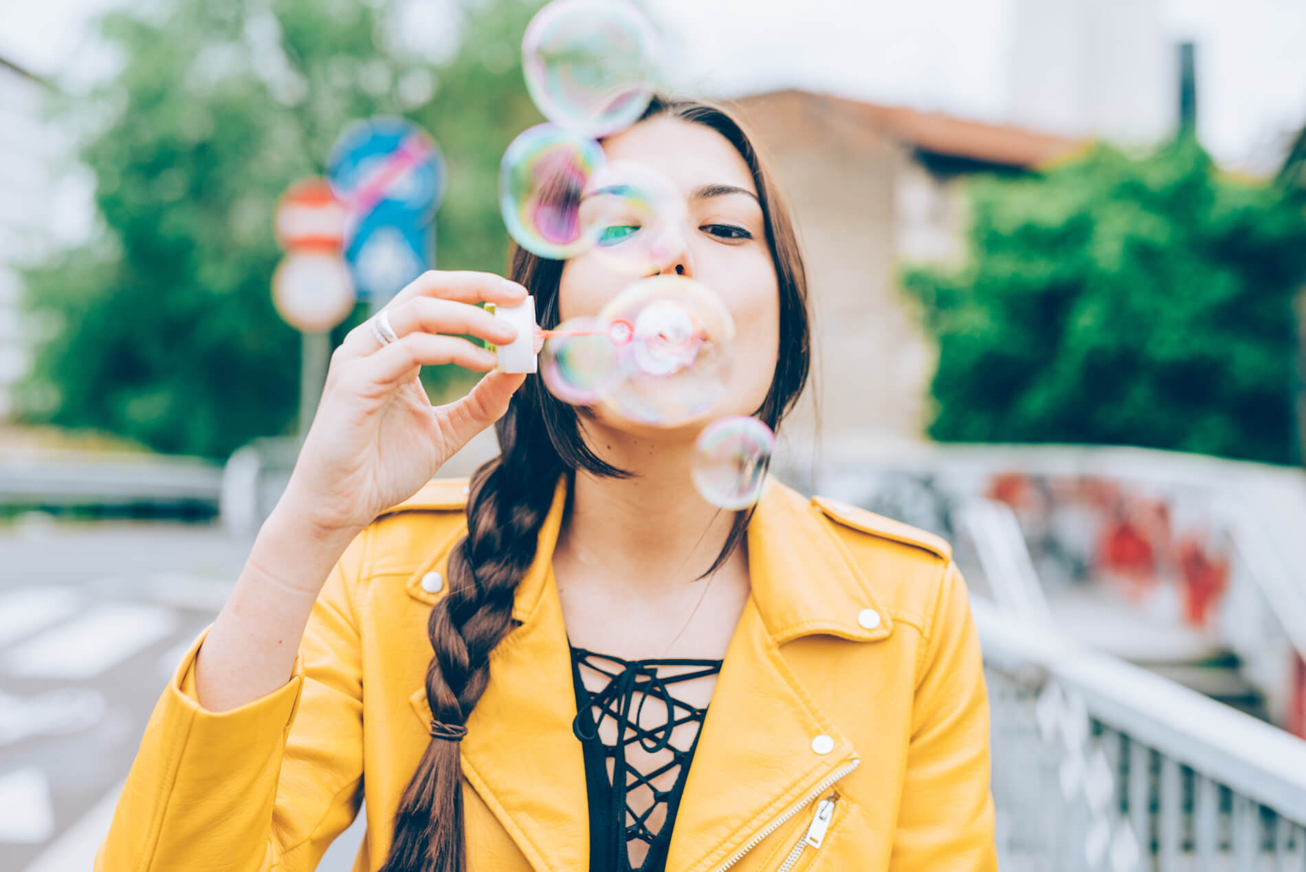 hipster-woman-playing-with-bubble-soap-PSK656C.jpg
