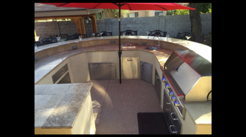 Curved Outdoor Kitchen with bar top counter.png