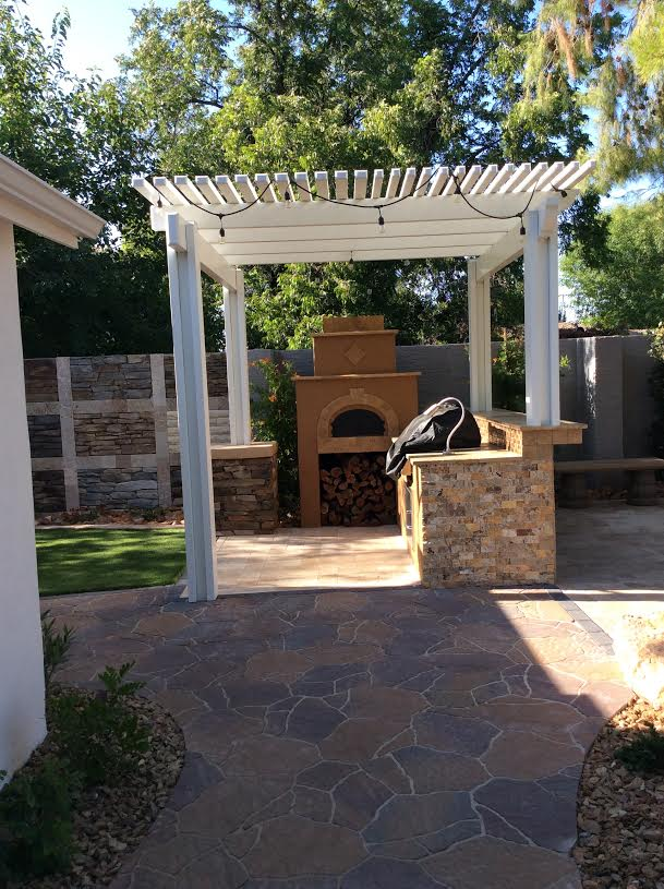Showroom Pergola, Pavers and BBQ Island with Pizza Oven.jpg