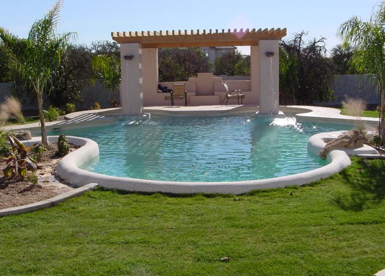 Raised stucco column and wood pergola with built in water feature.JPG