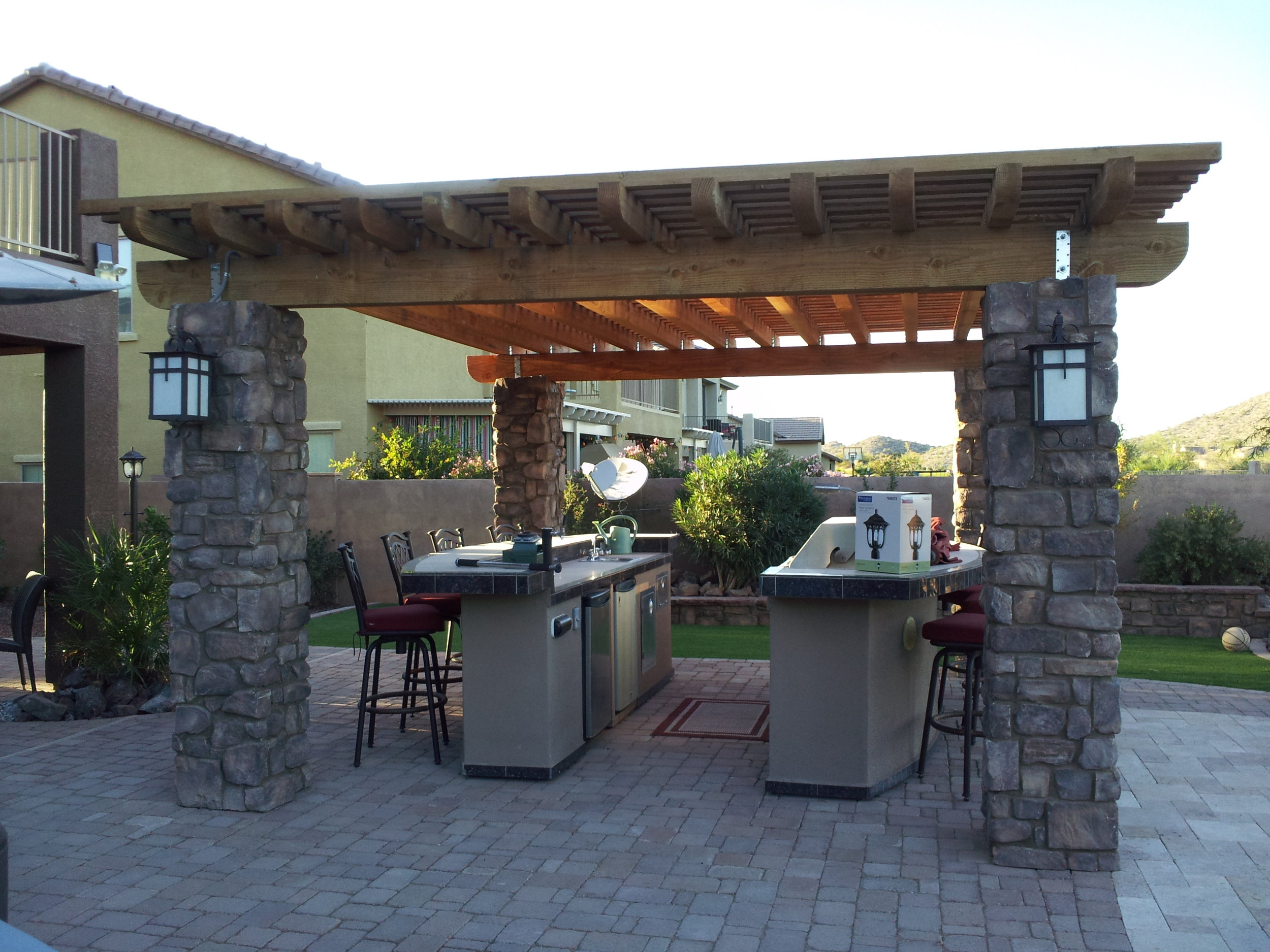 Stack Stone Columns and wood pergola.jpg