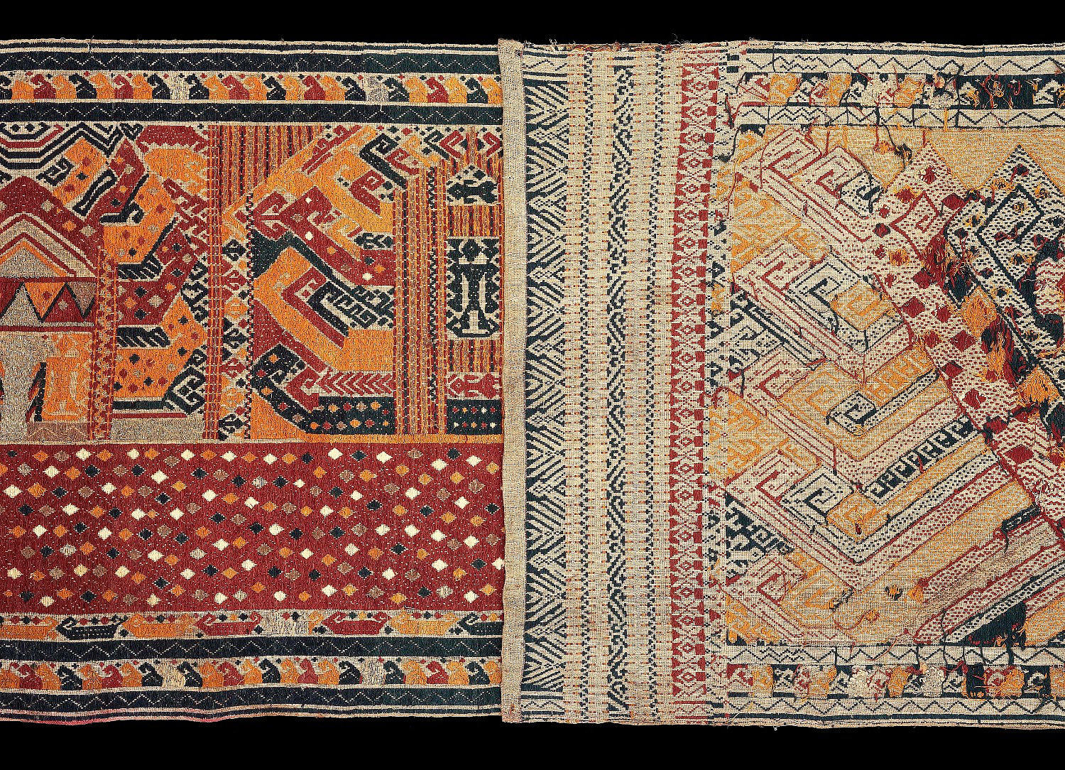 Detail of 1850-1900 long Palepi, ceremonial hanging.  Made of cotton with colored thread and gold thread supplementary weft pattern of figures on large red ship. All natural dyes. Pammingir people, Kota Agung, Lampung, south Sumatra, Indonesia.   303 X 58 cm   Samyama  Collection.