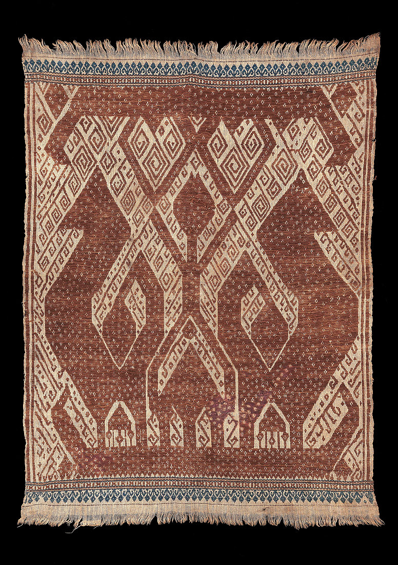 1880s' Tampan, ceremonial cloth for gift exchange.  Made of cotton with red and blue cotton supplementary weft of large ancestral figures flanked by a pair of giant birds on a ship, all natural dyes, South Sumatra, Indonesia.  69 x 52 cm   Samyama  Collection.