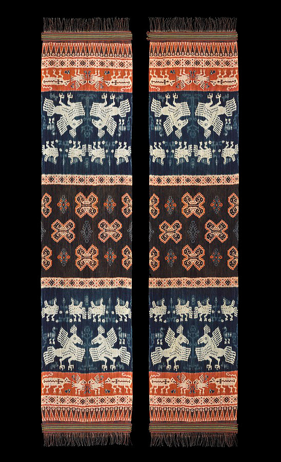 1970s Pair of Hinggi Kombu, man's ceremonial shawl.  Made of cotton with indigo and orange and dark purple brown ikat patterns. Natural dyes. Sumba people, woven in Umbu Ungngu, house of Uma Wara, Rende, East Sumba, Indonesia.  65 x 300 cm 70 x 300 cm   Samyama  Collection.