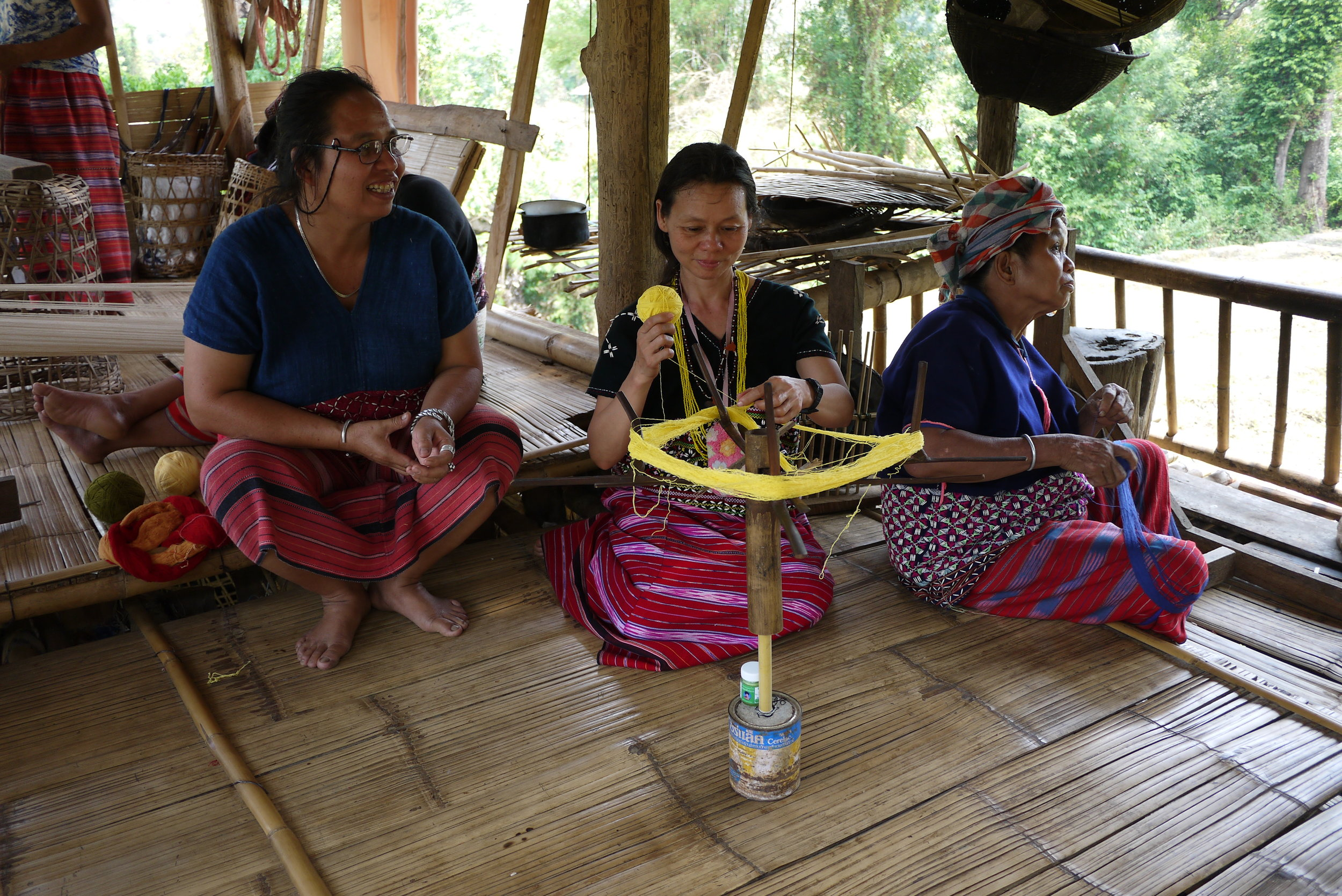 Weavers working at a Karen micro enterprise in Mae Chaem district, Chiang Mai Province, Thailand.