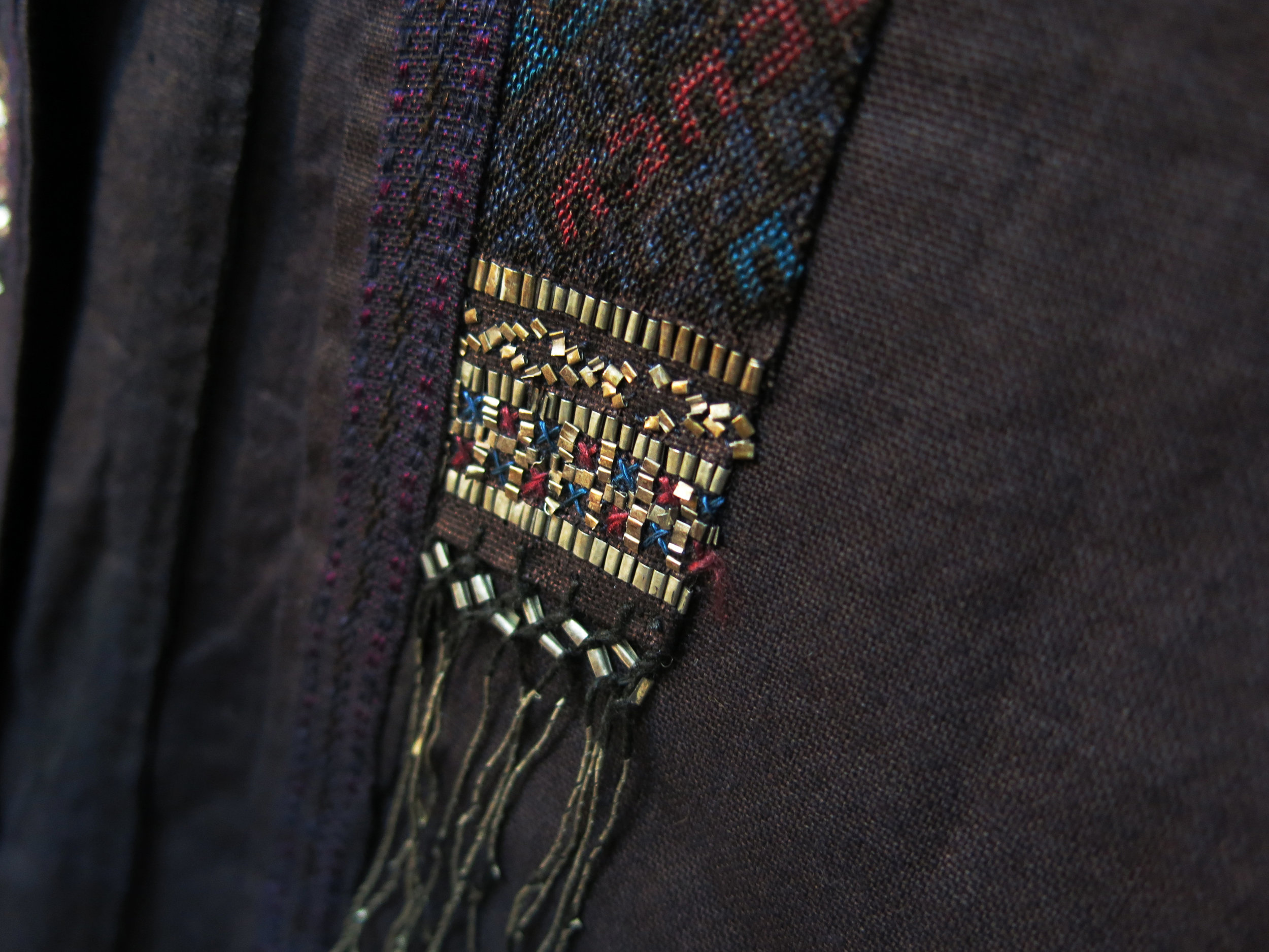 Edge of front collar with gimp tin embroidery
