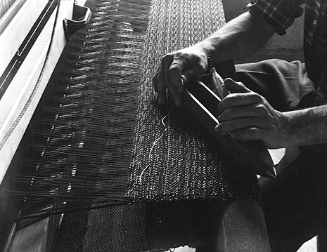 Student Bill Reed's hands at the loom, Black Mountain College, ca. 1938–42. Photograph by Claude Stoller