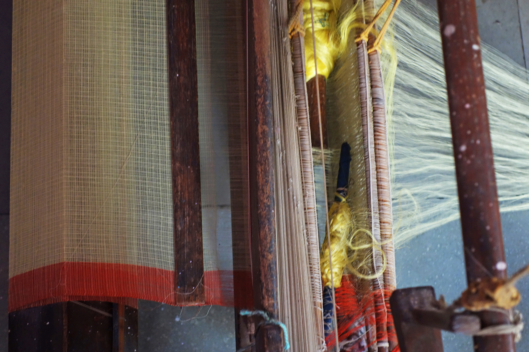 A detail of plain  khat  fabric being woven by Badrun Nisha