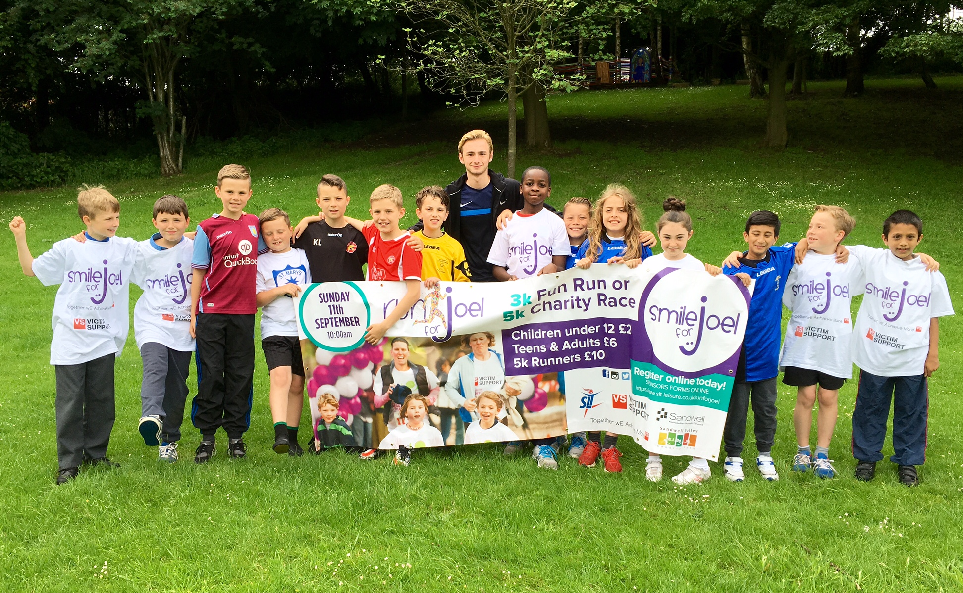 Showing off our banner for the 2016 RunforJoel Charity Fun Run and Marathon