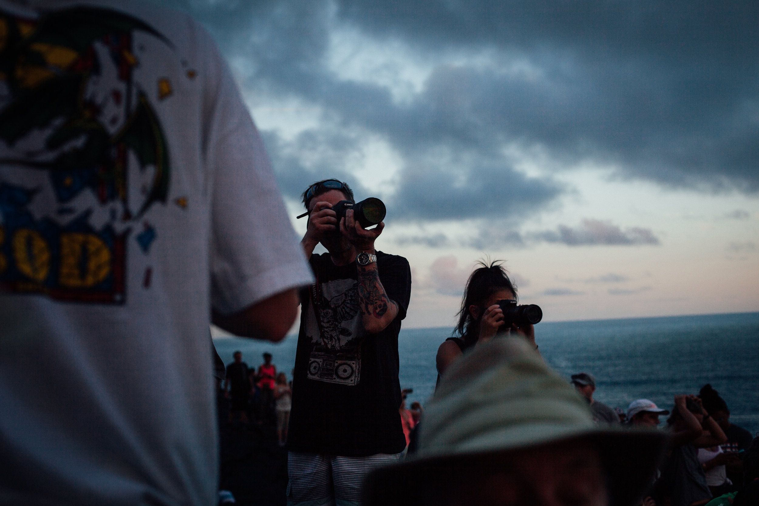 Photographers capturing the lava as it flows into the ocean